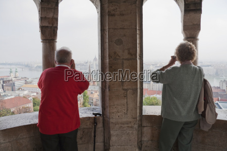 tourists looking at pest from the