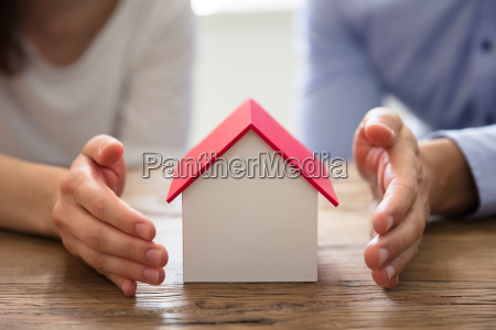 couple protecting house model