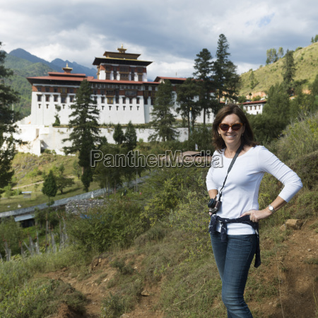a woman poses with rinpung dzong