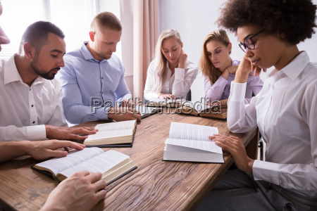 group of young multiethnic people reading