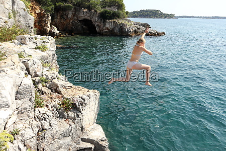 girl jumps in water