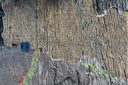 rough concrete wall with peeling paint