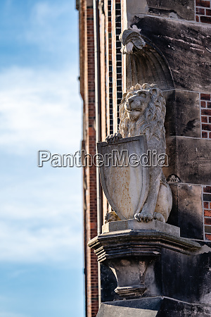 heraldic lion statue with shield