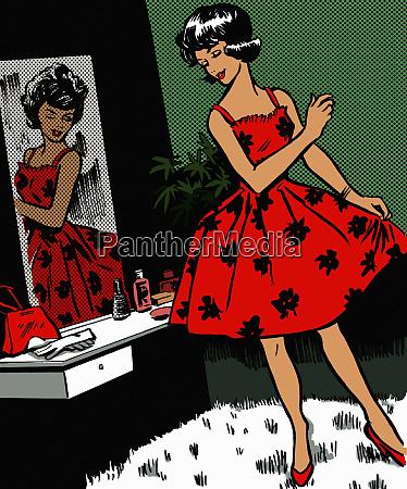 mulher retro que admira o vestido
