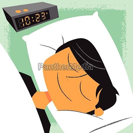 smiling man sleeping next to alarm