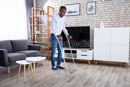 disabled man using crutches