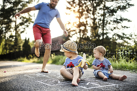 mature man playing hopscotch while his