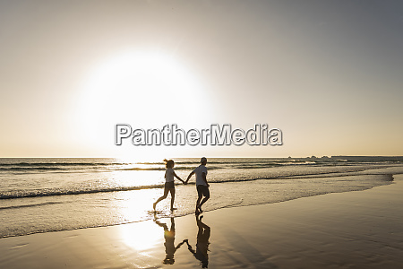 young couple doing a romantic beach