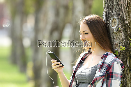 happy teen listening music on line