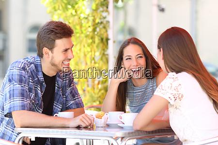 three happy friends talking in a
