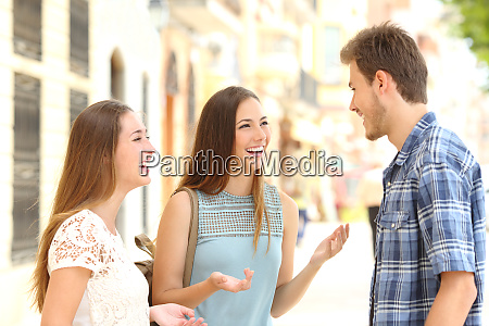 three smiley friends talking in the