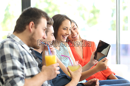 group of friends watching videos in