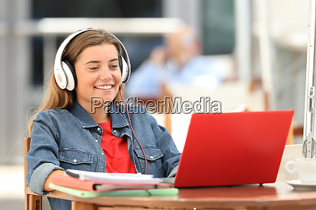 happy student relaxing watching on line