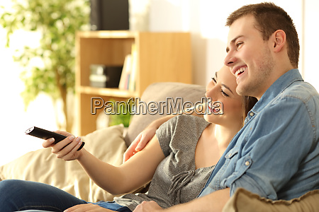 couple watching tv on a couch