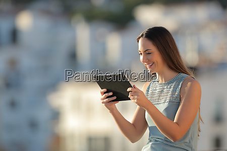 happy woman is watching media on