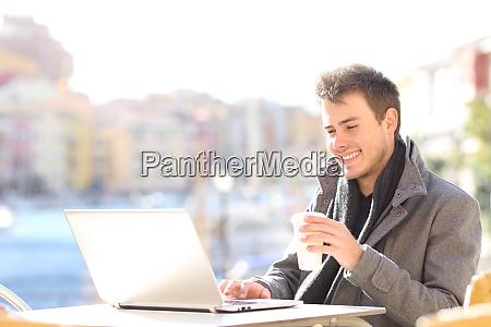 elegant man using a laptop in