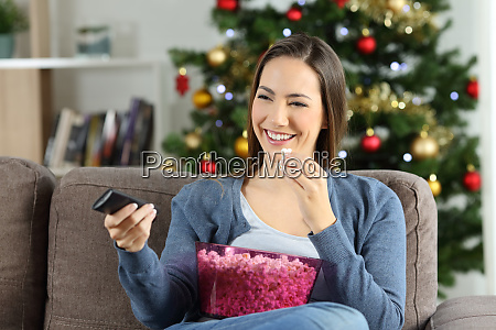 woman watching tv at home in