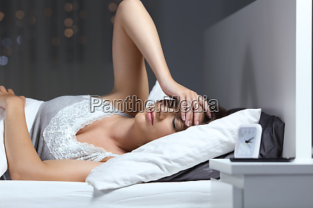 woman suffering headache in the bed