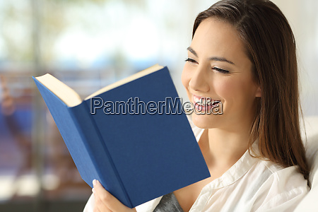 happy reader reading a book at