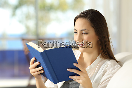 reader reading a paper book on