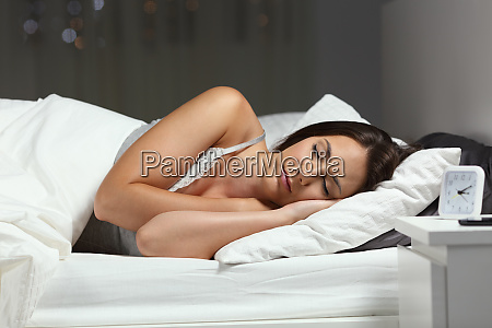 woman sleeping deeply in a bed