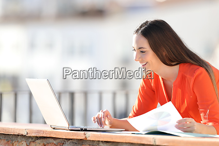 happy entrepreneur working with laptop and