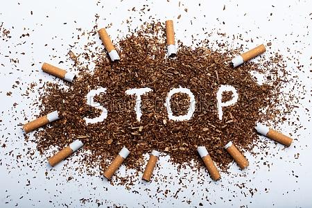 pare a palavra escrita no tabaco