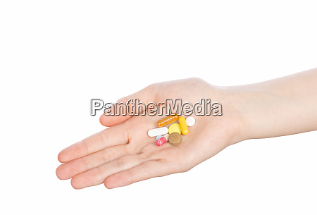 woman hand holding pills on white