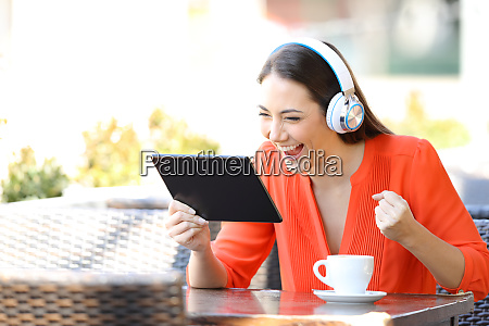 excited woman watching and listening media