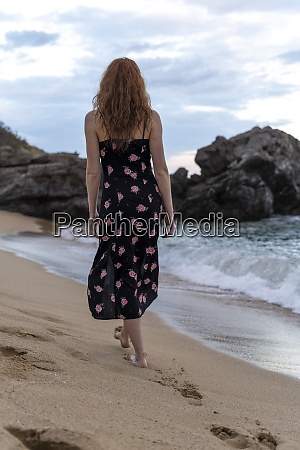 back view of young woman wearing