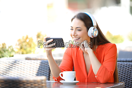 happy woman watching media on smart