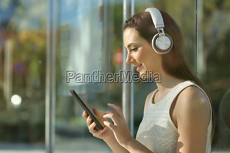 commuter listening to music with headphones