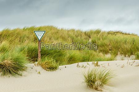 Area protegida por dunas sinal de