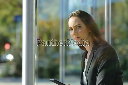 annoyed business woman waiting at the