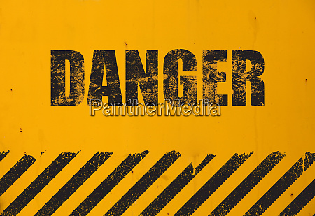 yellow background with black grunge danger