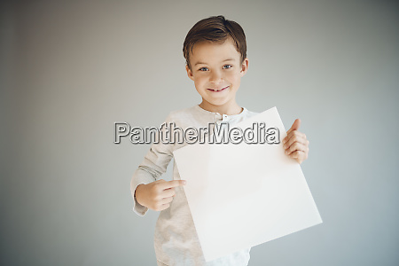 cool young boy is holding white