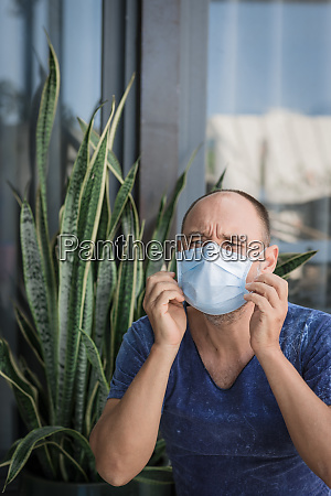 man wearing facial disposable mask virus