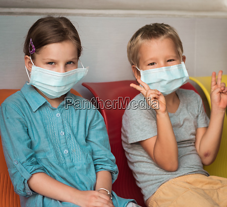 kids wearing facial disposable mask virus