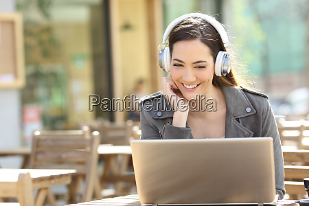 happy girl watching video on laptop
