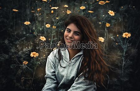 pretty girl on flowers meadow