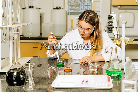 female laboratory technician researching medical samples