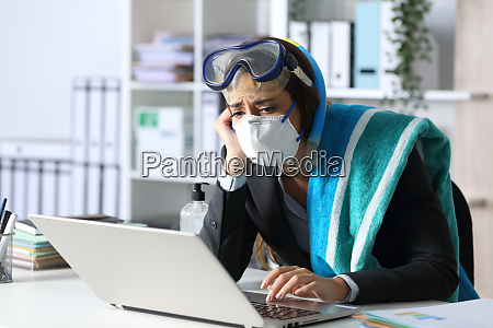 sad executive with mask cancelling vacation