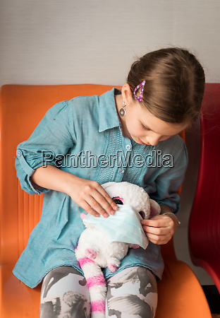 girl wearing facial disposable mask virus