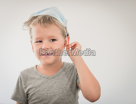 boy wearing facial disposable mask stop