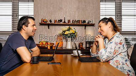 men and woman working on computers