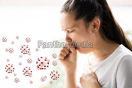 sick woman with flu infection coughing