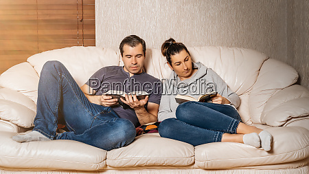 couple reading books from comfort of