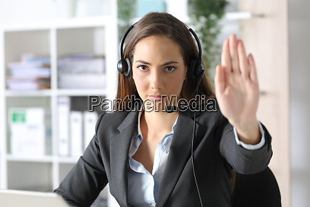 serious telemarketer woman gesturing stop at
