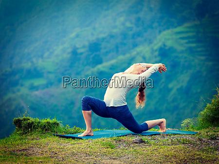 sporty fit woman practices yoga asana