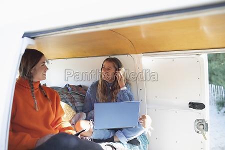 happy, young, women, friends, using, laptop - 30220859